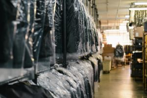 Drycleaned suits hung up ready for delivery